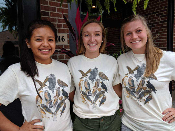 Ana, Savanna, Taylor showing off the front of the retro t-shirts!